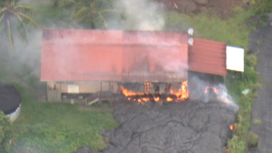 Raw video: Molten rock reaches rural house in Pahoa