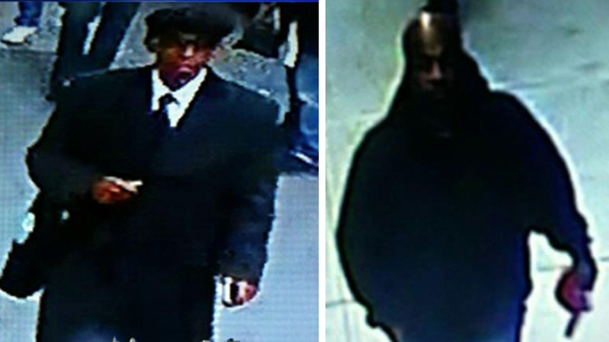 Police search for two men who violently robbed a watch store