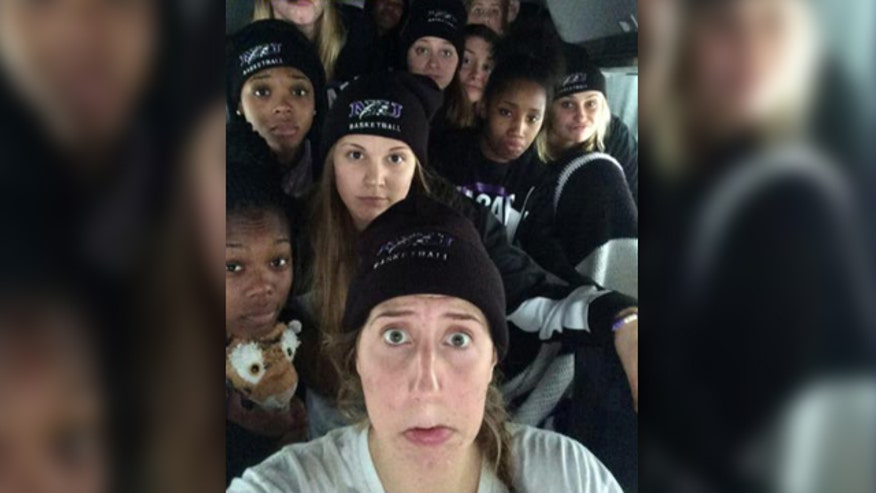 Niagara University women's basketball team marooned on New York State Thruway for nearly 30 hours by winter storm that dumped 4 feet of snow around Buffalo