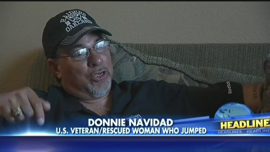 Donnie Navidad acted out of instinct when he jumped to save a woman falling at the Oakland Raiders' game.