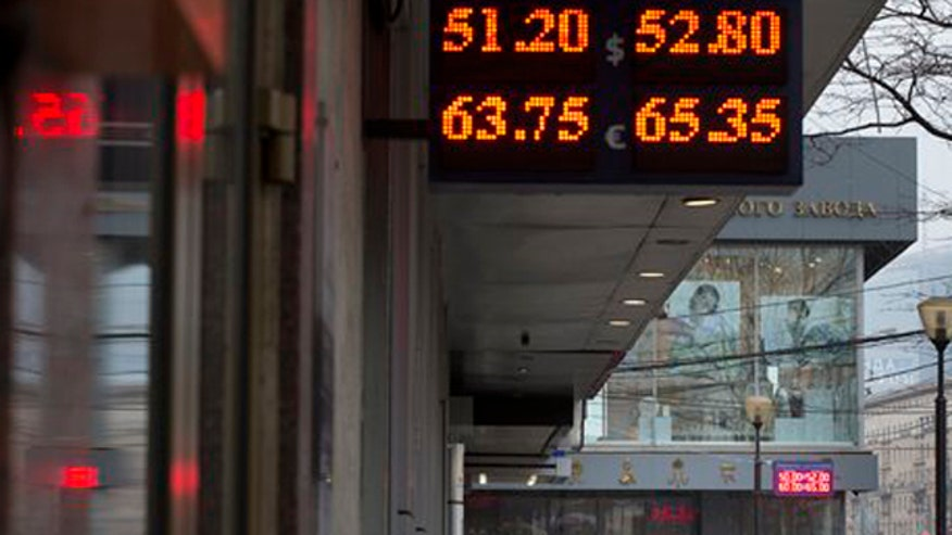 Russian official says economy will contract by 0.8% in 2015