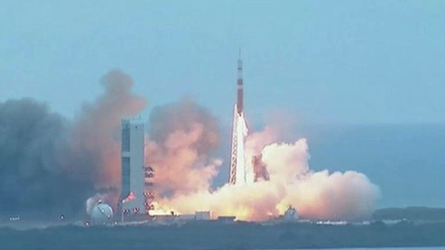 NASA's Orion spacecraft blasts off in historic test flight