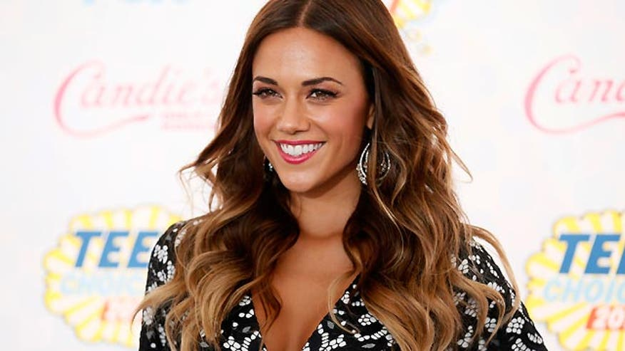 Jana Kramer's boyfriend surprises the singer with a ring and a proposal during Jana's birthday party.