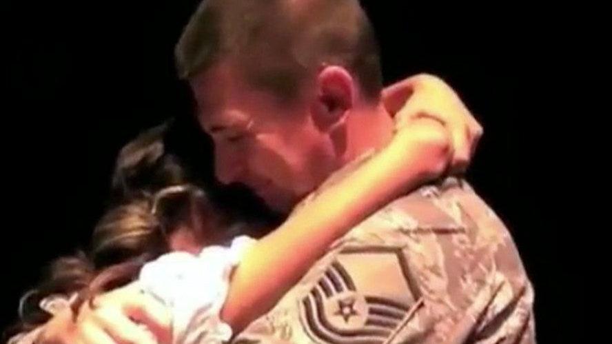 Airman surprises daughter at school play