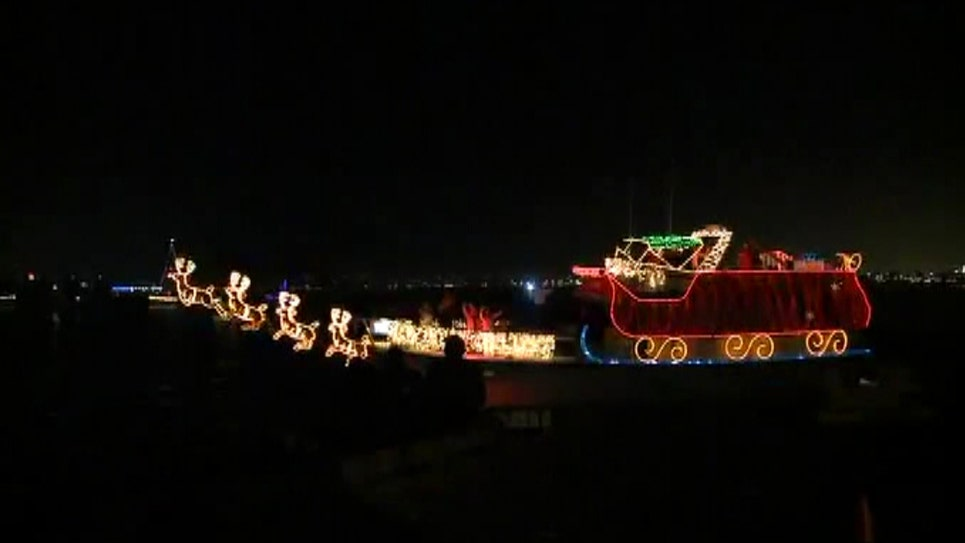 Boats replace floats in a parade of lights