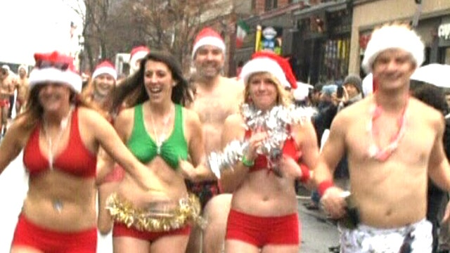 Speedo-sporting Santas sprint through streets