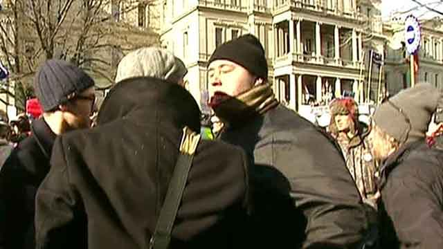 Angry union members get phsyical at Michigan protests