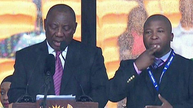 Fake sign language interpreter crashes Mandela memorial?