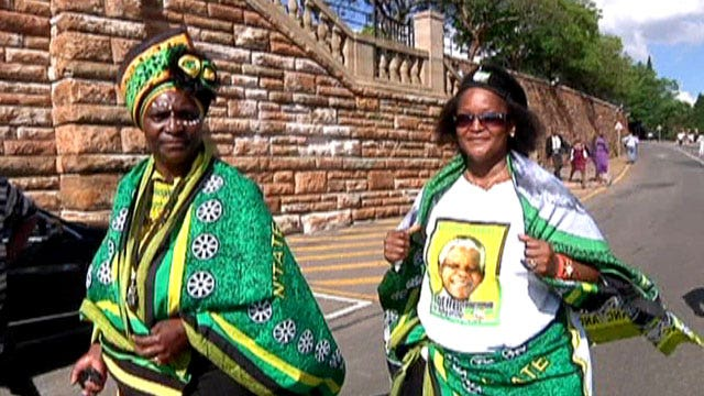 Mourners pay their final respects to Mandela