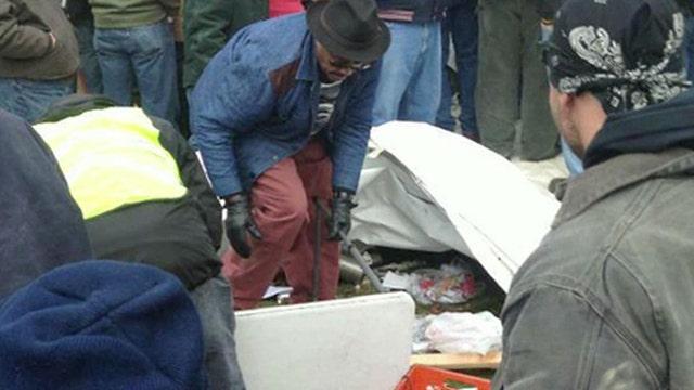 Hot dog vendor comes under attack at Michigan union protest