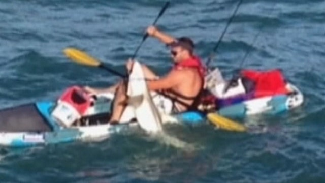 Shark fisherman knocked into water after big catch