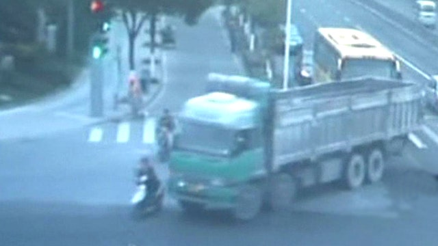 Truck runs over woman riding scooter