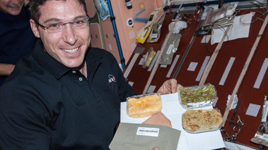 NASA provides a holiday meal for astronauts on the International Space Station.