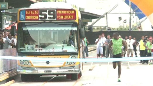 Bolt vs. bus: World's fastest man races transit vehicle