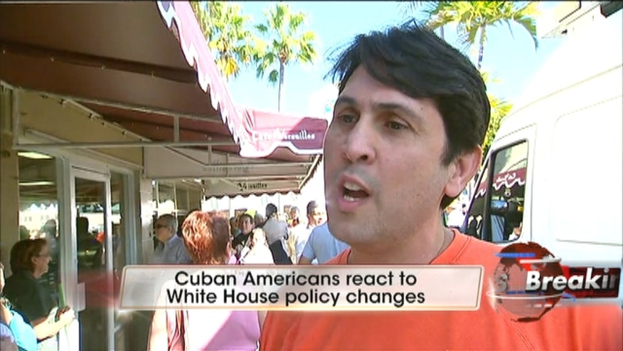 Cuban Americans in Miami's Little Havana neighborhood react to Obama's new policy changes toward Cuba.
