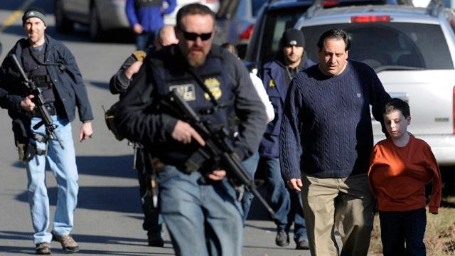 Reports of possible motive emerge in school massacre
