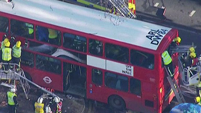 Double decker bus crashes in London