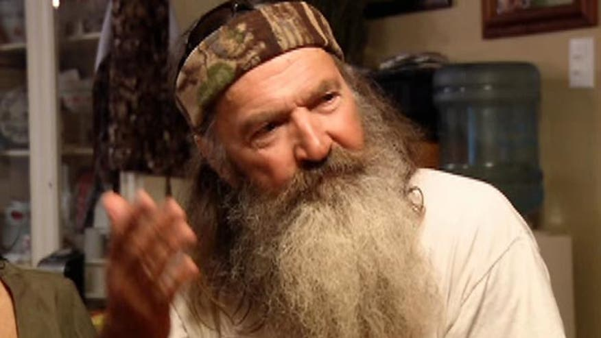Sponsors of the show stand with Phil Robertson