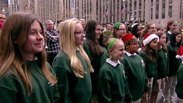 Girl Scouts sing Christmas carols