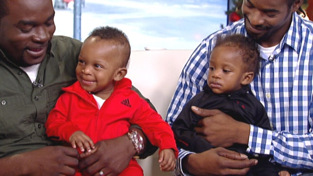 Neighbor catches twin babies thrown from burning building