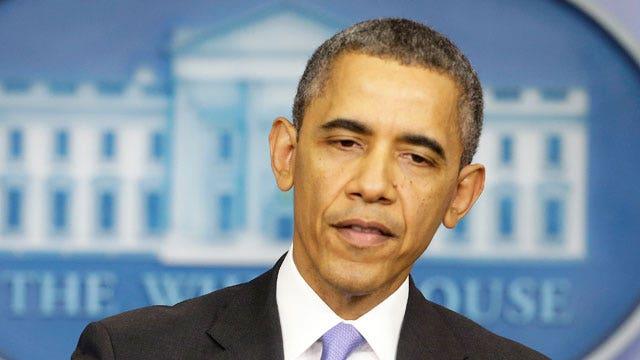 President defends ObamaCare to press