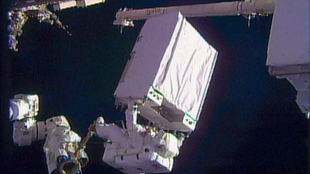 Astronauts take second spacewalk to fix cooling system