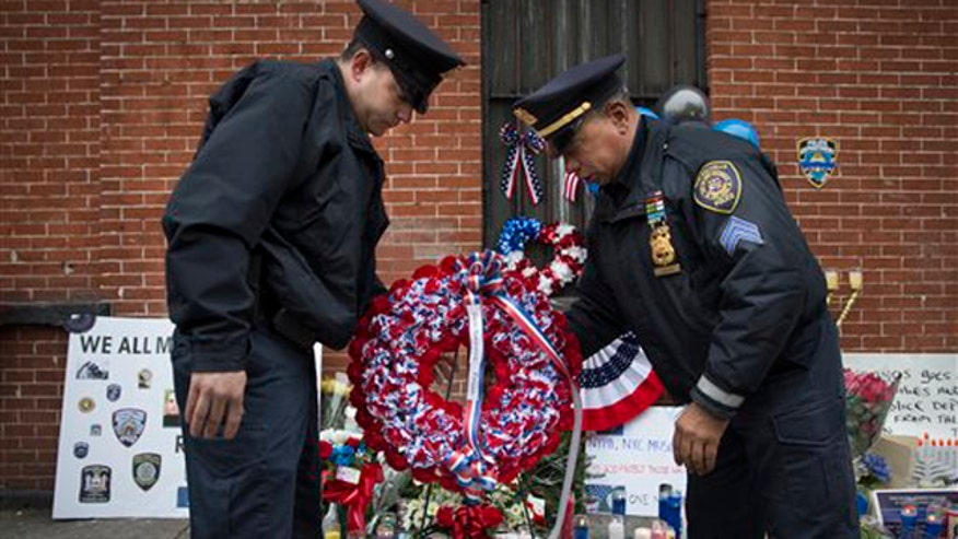 Mourners pay respects at wake for slain cop