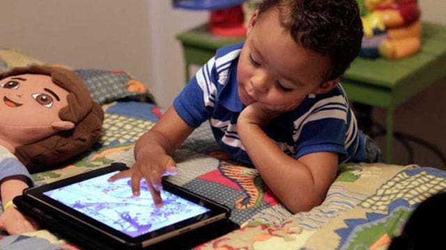 Does technology hinder or help child development?