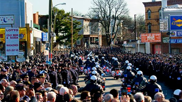 Sea of blue grief: 25,000 cops attend funeral for fallen NYPD officer