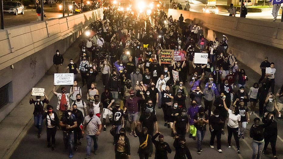 Oakland police assaulted during rioting; unrest prompts BART station closure