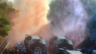 The Latest: G-20 protesters halt Hamburg march after clashes