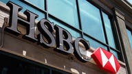 HSBC sets new cost cutting, earnings targets after profit falls 33%