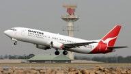 Qantas says Australia virus travel curbs cost it $71M in quarterly profit