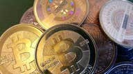 Bitcoin's value tops $1T for first time