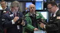 Dow touches record high as dealmaking booms