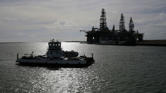 Oil prices climb on tropical storm and geopolitical tensions