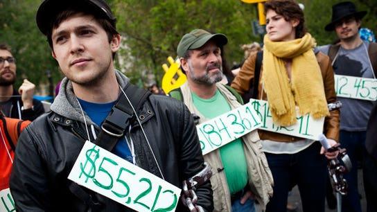 Survey: Americans Losing Battle Between Savings, Debt