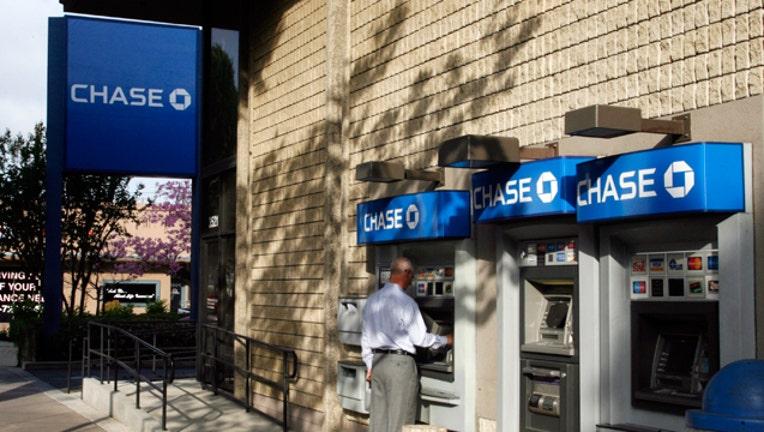 Jpmorgan chase plans to exit prepaid card business fox business jpmorgan colourmoves
