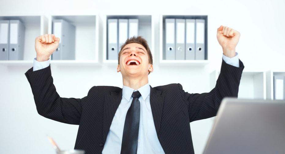 Young businessman celebrating his success