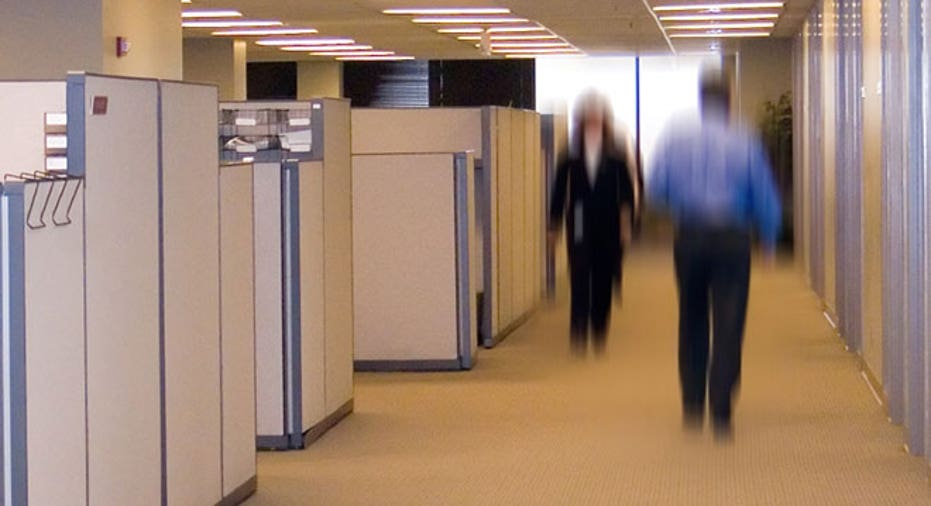 Workers Walk by Office Cubicles