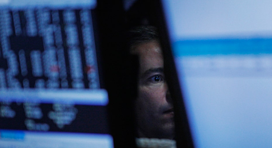 Stock Trader Surrounded by Monitors, Reuters
