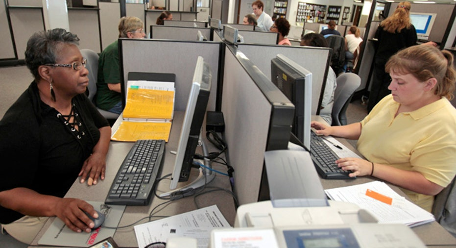 Employees on Computers in the Office