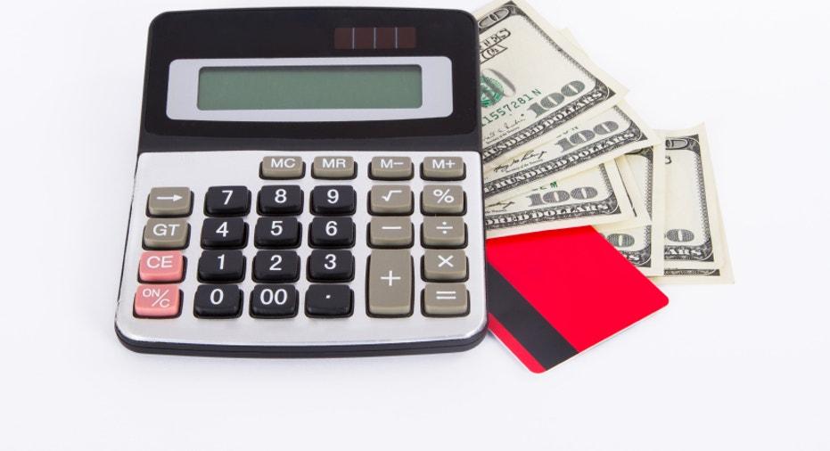 Credit Card, Dollar Bills and Calculator
