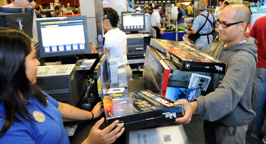 Customer Purchases Game at Best Buy Store