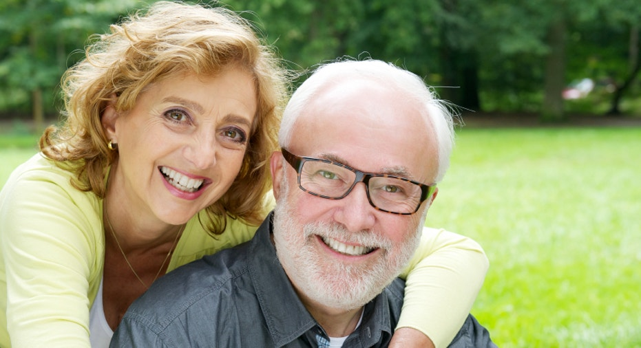 Happy older couple smiling  and showing affection
