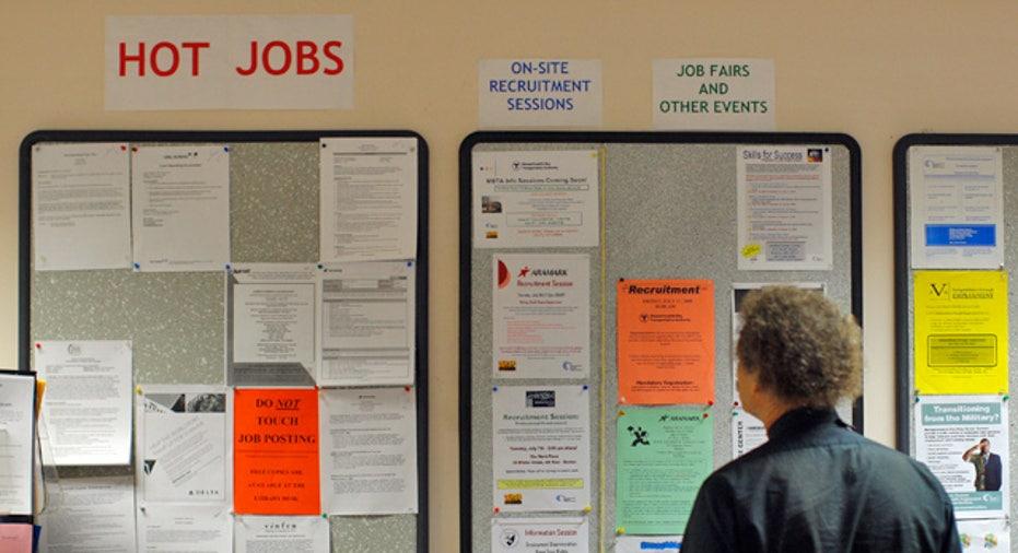 Man Looks at Job Posting Board