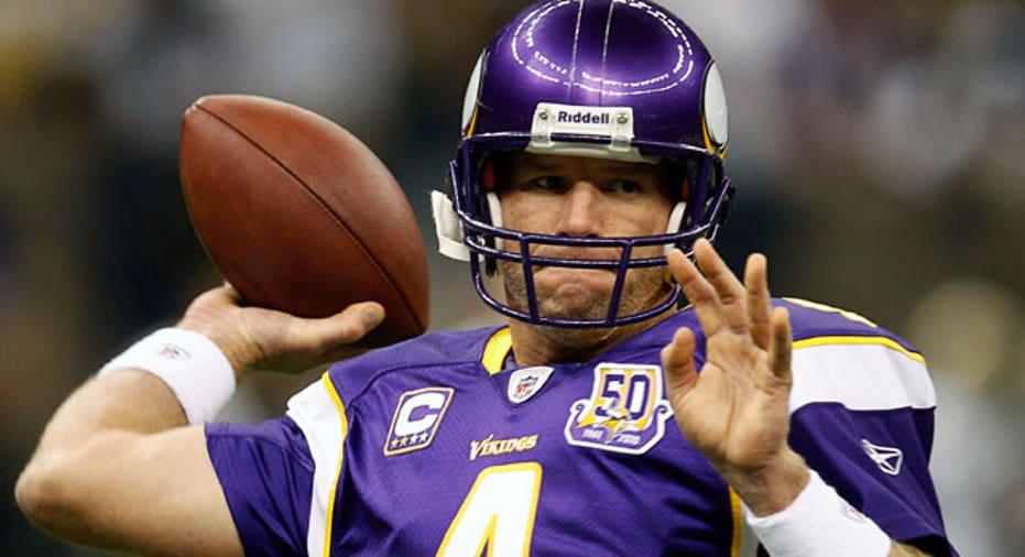 NFL Quarterback Brett Favre Throwing a Football
