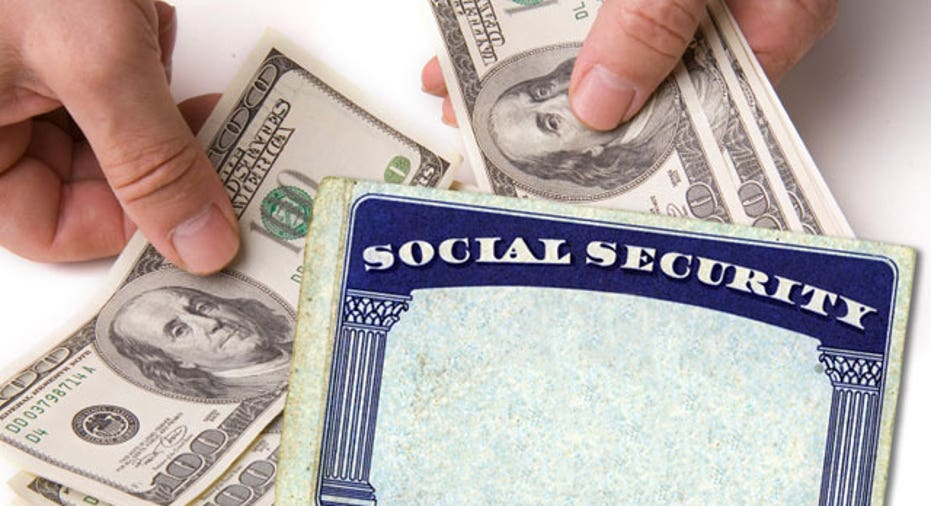 Social Security Card With Cash in Hands