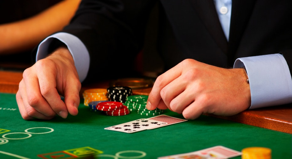 Dealer handling cards at a casino