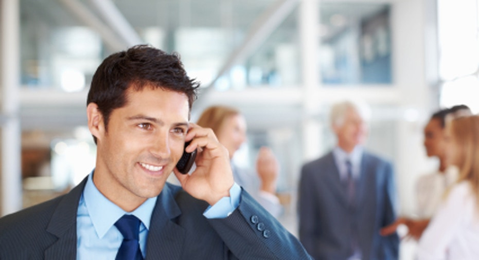 Male executive on call with team discussing